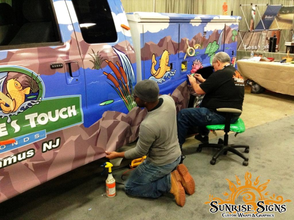 How are vehicle wraps installed