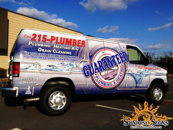 Plumbing contractor fleet vehicle wraps